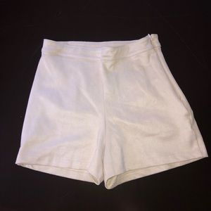 Beige suede Bebe high waisted shorts